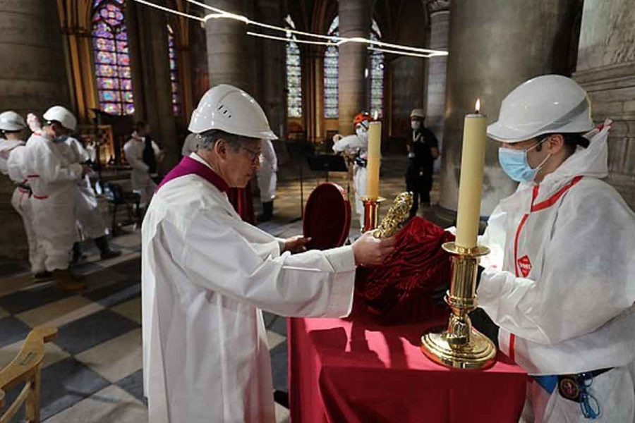 Notre Dame Cathedral marks Good Friday with just a handful of priests in hard hats